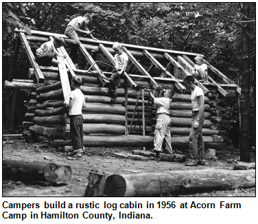 Campers build a rustic log cabin in 1956 at Acorn Farm Camp in Hamilton County, Indiana.