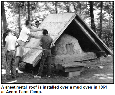 A sheet-metal roof is installed over a mud oven in 1961 at Acorn Farm Camp.
