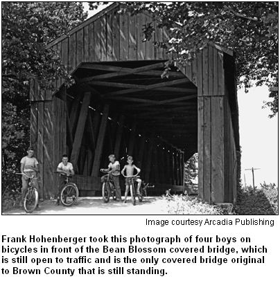 Frank Hohenberger took this photograph of four boys on bicycles in front of the Bean Blossom covered bridge, which is still open to traffic and is the only covered bridge original to Brown County that is still standing. Image courtesy Arcadia Publishing.