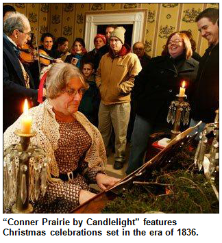 Image of period re-enactors playing piano and fiddle while onlookers in modern dress look on. Conner Prairie by Candlelight features Christmas celebrations set in the era of 1836.