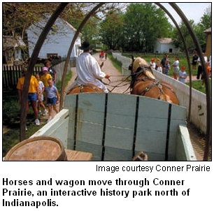 Horses and wagon move through Conner Prairie, an interactive history park north of Indianapolis. Image courtesy of Conner Prairie.