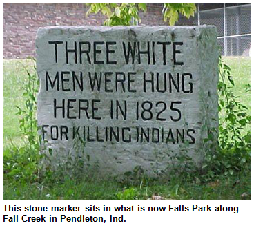 "This stone marker, commemorating the Fall Creek Massacre, sits in what is now Falls Park along Fall Creek in Pendleton, Ind. The text on the marker reads, ""Three white men were hung here in 1825 for killing Indians."""