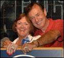 Charlotte and Forrest Lucas, with rings.