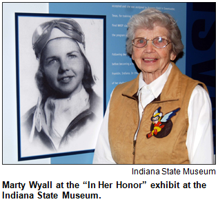 "Marty Wyall at the ""In Her Honor"" exhibit at the Indiana State Museum. Image courtesy Indiana State Museum."