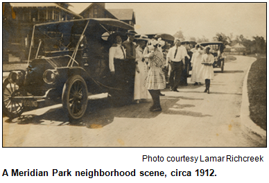 A Meridian Park neighborhood scene, circa 1912. People dressed formally and laughing in front of houses, on the street. Photo courtesy Lamar Richcreek.