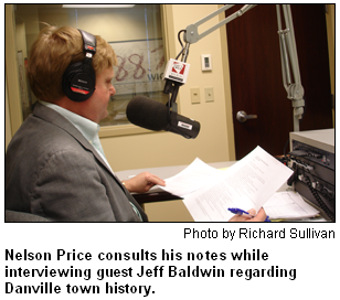 Nelson Price consults his notes while interviewing guest Jeff Baldwin regarding Danville town history. Photo by Richard Sullivan.