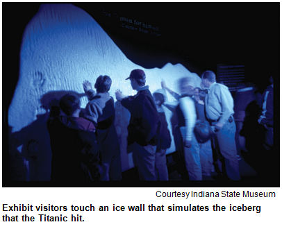 Exhibit visitors touch an ice wall that simulates the iceberg that the Titanic hit. Image courtesy Indiana State Museum.