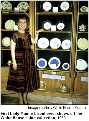 First Lady Mamie Eisenhower shows off the White House china collection, 1959. Image courtesy White House Museum.