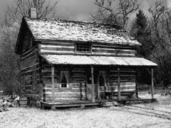 Log cabin in the snow.